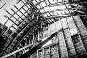 The decaying interior of this abandoned old barn with its lines, shapes, patterns and textures makes for a dramatic composition.