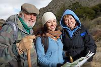 Family hiking in desert (portrait)