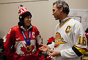 VANCOUVER, BC - MARCH 2: Trevor Linden, captain of the 1994 Vancouver Canucks talks to Caroline Ouellette captain of the 2014 Canadian Olympic Women's gold medal hockey team prior to the 2014 Tim Hortons Heritage Classic between the Ottawa Senators and the Vancouver Canucks at BC Place on March 2, 2014 in Vancouver, B.C., Canada.  (Photo by Kevin Light/NHLI via Getty Images)
