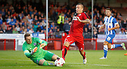 Jimmy Smith reaching for the ball under pressure from David Stockdale during the Pre-Season Friendly match between Crawley Town and Brighton and Hove Albion at the Checkatrade.com Stadium, Crawley, England on 22 July 2015. Photo by Michael Hulf.