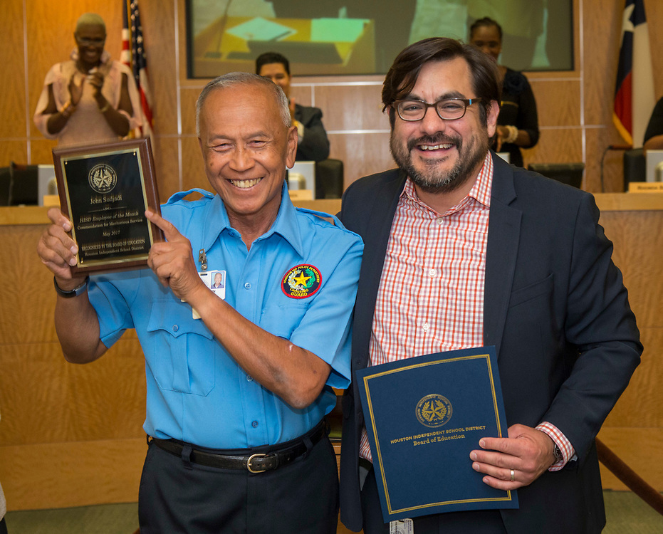 John Sudjadi is reconized by Benjamin Hernandez as Employee of the Month during a Board of Trustees meeting, April 13, 2017.