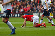 Joe Lolley (23) on his knees after a tackle during the EFL Sky Bet Championship match between Nottingham Forest and Bolton Wanderers at the City Ground, Nottingham, England on 5 May 2019.