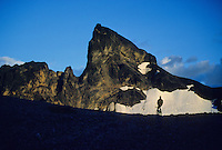 Mountain biker rests in front of the Black Tusk, a volcanic core mountain, near Whistler, BC