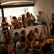 """August 27, 2014 - New York, NY :  Sofar Sounds, which produces """"secret"""" concerts in volunteers' apartments in 37 countries, threw a listening party for the debut of Karen O's new solo album """"Crush Songs"""" -- with performances by the band """"BOYTOY"""" and Julia Easterlin -- in Tribeca on Wednesday evening. The evening concluded with a surprise appearance, and performance, by Karen O and Moses Sumney. Pictured here, Julia Easterlin, at right, smiles as the audience applauds after her performance. CREDIT: Karsten Moran for The New York Times"""