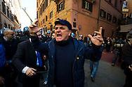 Roma 9 Marzo 2012.Manifestazione dei Movimenti per il diritto all'abitare davanti al CIPE, Comitato Interministeriale per la Programmazione Economica,che oggi doveva stanziare 20 milioni di euri per la compensazione per la TAV,i manifestanti protestavano per l'uso del denaro pubblico in opere come la TAV.La polizia  a caricato e fermato alcuni manifestanti..Nella foto : i manifestanti tentano di strappare un fermato alla polizia.