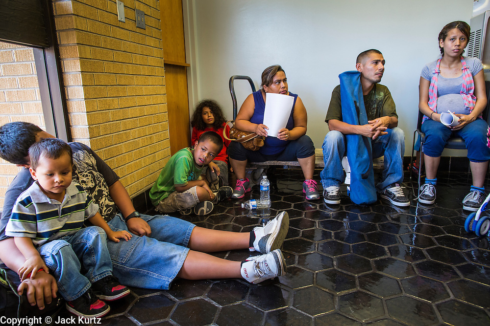 """25 AUGUST 2012 - PHOENIX, AZ:  Immigrant families wait to be called into a workshop to learn about the deferred action program. Hundreds of people lined up at Central High School in Phoenix to complete their paperwork to apply for """"Deferred Action"""" status under the Deferred Action for Childhood Arrivals (DACA) program announced by President Obama in June. Volunteers and lawyers specialized in immigration law helped the immigrants complete the required paperwork. Under the program, the children of undocumented immigrants brought to the US before they turned 16 years old would not be subject to deportation if they meet a predetermined set of conditions.    PHOTO BY JACK KURTZ"""