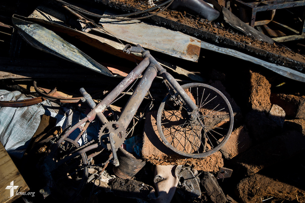 A charred bicycle lays among the debris  Monday, April 21, 2014, on a hillside of homes affected by a devastating fire in Valparaíso, Chile. The catastrophic fire that tore through the hillsides above the historic port city fire killed 15 people, destroyed about 3000 homes, and left approximately 15,000 people homeless.  LCMS Communications/Erik M. Lunsford