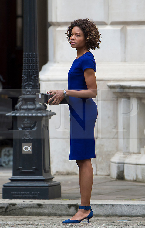 "© Licensed to London News Pictures. 30/05/2015. London, UK. Filming for the new James Bond film ""Spector"" with Daniel Craig (not pictured) and Naomie Harris (pictured) at the courtyard of the UK Government Treasury building in Westminster, London . Photo credit: Ben Cawthra/LNP"