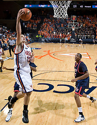 Virginia guard Sammy Zeglinski (13) leaps for a layup against Howard. The Virginia Cavaliers men's basketball team faced the Howard Bison at the John Paul Jones Arena in Charlottesville, VA on November 14, 2007.