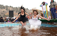 NEDERLAND, CO - MARCH 10: Two women jump into icy brown water in the Frozen Dead Guy Days Polar Plunge competition at the event on March 10, 2018 in Nederland, Colorado. The Frozen Dead Guy Days festival is in honor of Bredo Morstol, who is frozen on dry ice and housed in a shed above the town. (Photo by Rick T. Wilking/Getty Images)