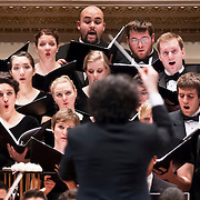 "December 12, 2012 - New York, NY : Conductor Gustavo Dudamel, on pedestal, leads the  Westminster Symphonic Choir (pictured here) and the Simón Bolívar Symphony Orchestra (not visible) of Venezuela as they perform Antonio Estévez's ""Cantata criolla"" at Carnegie Hall's Stern Auditorium / Perelman Stage on Tuesday evening. **THIS IMAGE IS A CROP VARIATION**   CREDIT: Karsten Moran for The New York Times"
