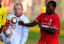 Wayne Rooney in action in a bad tempered game in which he abused local official Jeff Selogilwe . Platinum Stars v England World Cup Warm-Up Match - Moruleng Stadium, Moruleng, North West Province, South Africa, 7th June 2010