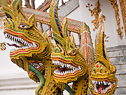 24 JUNE 2011 - CHIANG MAI, THAILAND: A naga serpent guards the entrance to the viharn at Wat Bupparam in Chiang Mai. A Naga is a representation of a mystical serpent that according to the holy scripts sheltered the Buddha while he was meditating. Wat Bupparam is built in the Burmese style and was built by Burmese teak merchants who settled in Chiang Mai.   PHOTO BY JACK KURTZ