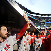 NEW YORK, NEW YORK - May 19: Daniel Murphy #20 of the Washington Nationals congratulates team mates in the dugout after a Washington run during the Washington Nationals Vs New York Mets regular season MLB game at Citi Field on May 19, 2016 in New York City. (Photo by Tim Clayton/Corbis via Getty Images)