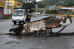 May 3, 2017 - Valencia, Carabobo, Venezuela - A car looks burned and abandoned in the middle of the San Blas sector. People blocked streets to protest the socialist president's bid to rewrite the constitution amid a rapidly escalating political crisis.  (Credit Image: © Juan Carlos Hernandez via ZUMA Wire)