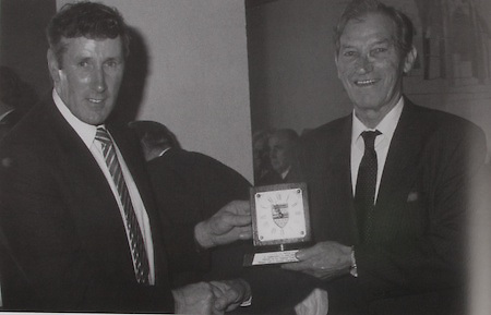 """Tipperary Chairman in 1989 Noel Morris makes a presentation to Johnny Ryan, Moycarkey, caption of the 1941 Munster Champion (Lovingly referred to the foot and mouth All-Ireland champions in Tipperary). Johnny won an All-Ireland medal in 1937 along with his brother """"Sweeper"""". """"Sweeper"""" and another brother """"Mutt"""" won medals in 1945."""