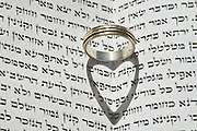Jewish Wedding concept Wedding ring on Jewish Text (Ketubah)