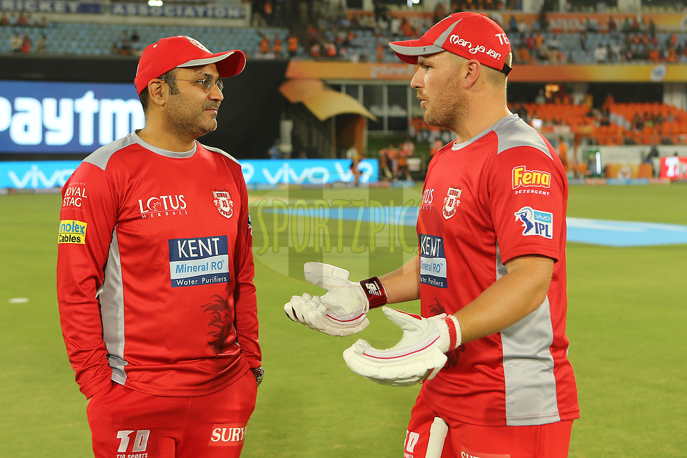 Virender Sehwag and Aaron Finch during match twenty five of the Vivo Indian Premier League 2018 (IPL 2018) between the Sunrisers Hyderabad and the Kings XI Punjab  held at the Rajiv Gandhi International Cricket Stadium in Hyderabad on the 26th April 2018.<br /> <br /> Photo by: Ron Gaunt /SPORTZPICS for BCCI