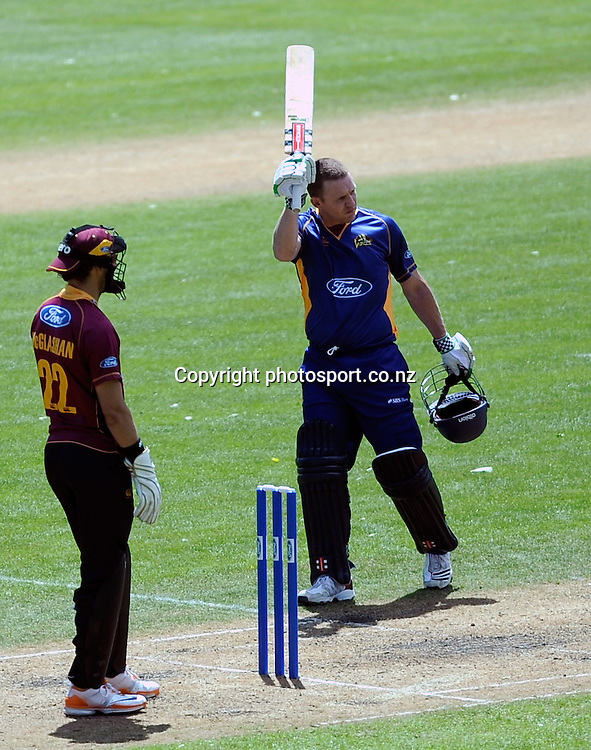 Craig Cumming Celebrates his 100 runs,  Men's 1 Day competition cricket match between, Otago Volts v Northern Knights, at the University oval, Dunedin, New Zealand. Friday 25 November 2011 . Photo: Richard Hood photosport.co.nz