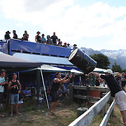 Men joust with a barrel during the 50th Anniversary Glenorchy Race meeting. The races, which originally started in the 1920's, were resurrected in 1962 and have been run by local farmers and the rugby club on the first Saturday after New Years Day ever since. Glenorchy, Otago, New Zealand. 7th January 2012