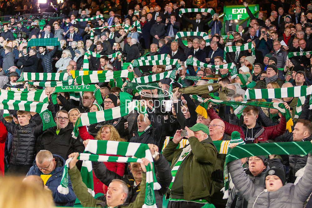 Celtic fans rais their scarf's as they sing the clubs anthem  during the Europa League match between Celtic and Rennes at Celtic Park, Glasgow, Scotland on 28 November 2019.