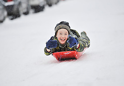 © Licensed to London News Pictures. 20 January 2013. Chipping Norton, Oxfordshire.Kyle Hurley (8) Probably the best Street in England for sledging? Residents of The Leys in Chipping Norton have made a super sledging run in the road. The local children even prevented council workers from salting the road by sitting down across the road to block the gritters. Everyone who live in the Leys seems to love the sledging run and have even joked that they want to apply for a ski lift to be installed for future years fun.. Photo credit : MarkHemsworth/LNP