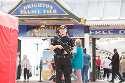 © Licensed to London News Pictures. 16/09/2017. Brighton, UK. Armed Police officers on patrol on the Brighton Palace Pier in Brighton and Hove as the threat level in the UK is increased to Critical in the wake of the Parsons Green tube bomb attack on Friday morning.Photo credit: Hugo Michiels/LNP