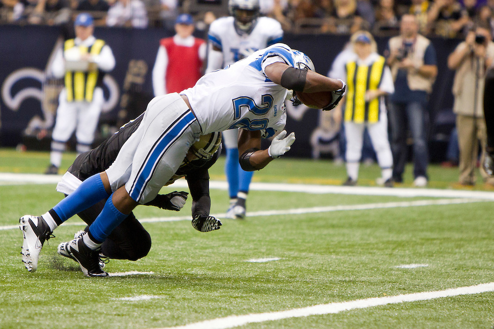 NEW ORLEANS, LA - DECEMBER 4:   Maurice Morris #28 of the Detroit Lions is hit as he dives for the end zone by Scott Shanie #58 of the New Orleans Saints at Mercedes-Benz Superdome on December 4, 2011 in New Orleans, Louisiana.  The Saints defeated the Lions 31-17.  (Photo by Wesley Hitt/Getty Images) *** Local Caption *** Maurice Morris; Scott Shanie