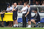 AFC Wimbledon manager Neal Ardley, AFC Wimbledon first team coach Simon Bassey and AFC Wimbledon assistant coach Neil Cox looking deep in thought on the touchline during the EFL Sky Bet League 1 match between AFC Wimbledon and Oldham Athletic at the Cherry Red Records Stadium, Kingston, England on 21 April 2018. Picture by Matthew Redman.