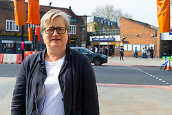 Local and GLC Councillor Caroline Russell (Green Party) at the intersection at Highbury Corner where temporary traffic lights give pedestrians, who have to wait 60 seconds, just 6 seconds of green to cross the busy A1, a major arterial road, outside the entrance to the Highbury & Islington Tube station. London, April 18 2019.
