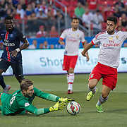Paris St. Germain's Serge Aurier (left) and goalkeeper Kevin Trapp and SL Benfica's Pizzi in the International Champions Cup in Toronto.