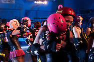 Skaters from both teams embrace after the end of the the C-Max Roller Derby league Deathrow Demolition Derby bout, July 28 2012. The Raging Warmones versus the Thundering Hellcats, Johannesburg, South Africa.
