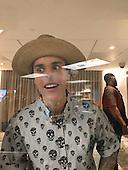 EXCLUSIVE- Justin Bieber draws love heart on windown of hotel kids club