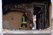 Roma, 20 Gennaio  2015<br /> Un morto e numerosi feriti per l'esplosione di una bombola del gas in un appartamento vuoto al primo piano dello stabile di via Giuseppe Galati 54, nel quartiere Colli Aniene, alla periferia est di Roma. Ricercata dalla polizia, l'inquilina 82enne, che aveva ricevuto l'ingiunzione di sfratto e sembra che aveva minacciato di far saltare in aria la casa. Vigili del fuoco sul luogo dell esplosione<br /> Rome, January 20, 2015<br /> One dead and many wounded by the explosion of a gas cylinder in an empty apartment on the first floor of the building in Via Giuseppe Galati 54, in the district Colli Aniene, in the eastern outskirts of Rome. Wanted by the police, tenant a woman of 82 year, who  had received an order of eviction and that it seems that he had threatened to blow up the house. Firefighters on the site of the explosion