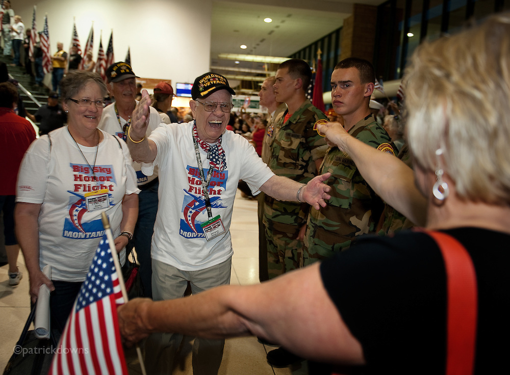 An overjoyed Ken Williams, WWII veteran, is greeted with outstretched arms on his return to Billings with the MT Honor Flight to Washington D.C.