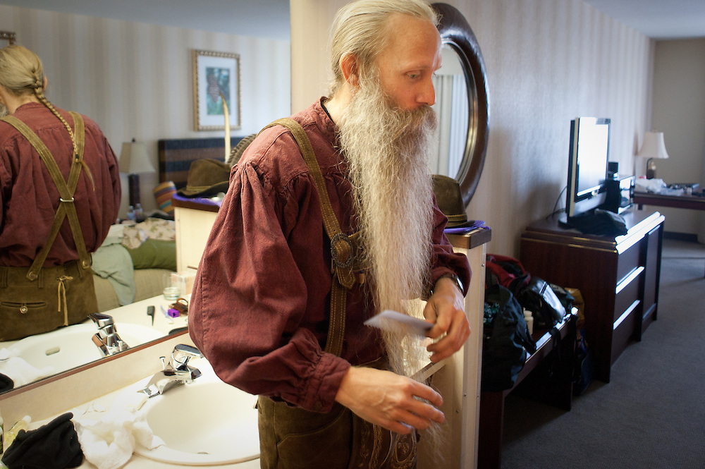 Aarne Bielefeldt of Willits, California prepares his beard for competition at his hotel room. Bielefeldt took first in the full beard natural category in Bend, Oregon on Saturday, June 5, 2010 at the Beard Team USA National Beard and Mustache Championships. He wore a traditional Bavarian costume.