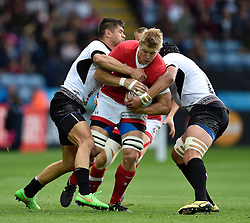 John Moonlight of Canada takes on the Canada defence - Mandatory byline: Patrick Khachfe/JMP - 07966 386802 - 06/10/2015 - RUGBY UNION - Leicester City Stadium - Leicester, England - Canada v Romania - Rugby World Cup 2015 Pool D.