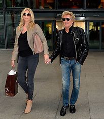 SEP 11 2014 Rod Stewart and Penny Lancaster arrive at Heathrow Airport