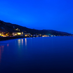 Malibu California coastline at night photo in blue. Malibu is a coastal city along the Pacific Ocean in Southern California in the United States. Copyright ⓒ 2015 Paul Velgos with All Rights Reserved.