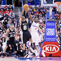 18 February 2014: San Antonio Spurs point guard Patty Mills (8) takes a jumpshot over Los Angeles Clippers point guard Darren Collison (2) during the San Antonio Spurs 113-103 victory over the Los Angeles Clippers at the Staples Center, Los Angeles, California, USA.