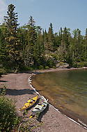 Kayaks on a gravel beach of Belle Isle on Isle Royale National Park.