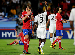 A dejected Nemanja Vidic (Serbia) after Asamoah Gyan scores during the 2010 FIFA World Cup South Africa Group D match between Serbia and Ghana at Loftus Versfeld Stadium on June 13, 2010 in Pretoria, South Africa.