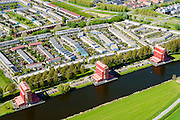 Nederland, Flevoland, Almere, 07-05-2015; Almere-Buiten, Regenboogbuurt met aan het water van de Lage Vaart de Rooie Donders van architect Liesbeth van der Pol. Residential distict 'Rainbow Area'. Next to the canal Lage Vaart some red buildings called Rooie Donders (red devils) by architect Liesbeth van der Pol.<br /> <br /> luchtfoto (toeslag op standard tarieven);<br /> aerial photo (additional fee required);<br /> copyright foto/photo Siebe Swart