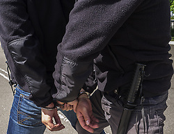 May 16, 2015 - Police keeps a criminal with handcuffs (Credit Image: © Igor Golovniov/ZUMA Wire/ZUMAPRESS.com)