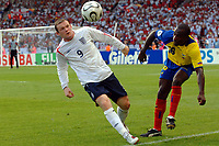 Photo: AF Wrofoto/Sportsbeat Images.<br />England v Ecuador. 2nd Round, FIFA World Cup 2006. 25/06/2006.<br />England's Wayne Rooney looks to control the ball.