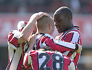 .Photo Peter Spurrier.06/04/2002.Nationwide Div 2.Brentford vs Huddersfield - Griffen Park:.Lloyd Osusu (Right), congratulates, Martin Rowlands (No.11) on his goal...