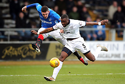 Rangers' Kyle Lafferty (left) and Dundee's Genseric Kusunga battle for the ball during the Scottish Premiership match at Dens Park, Dundee.