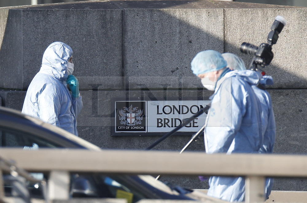 © Licensed to London News Pictures. 30/11/2019. London, UK. Police forensics officers are seen working on London Bridge the day after a terrorist attack. Two people were killed and three injured after the attacker, named by police as 28-year-old Usman Khan stabbed a man and a woman to death on London Bridge. Photo credit: Peter Macdiarmid/LNP
