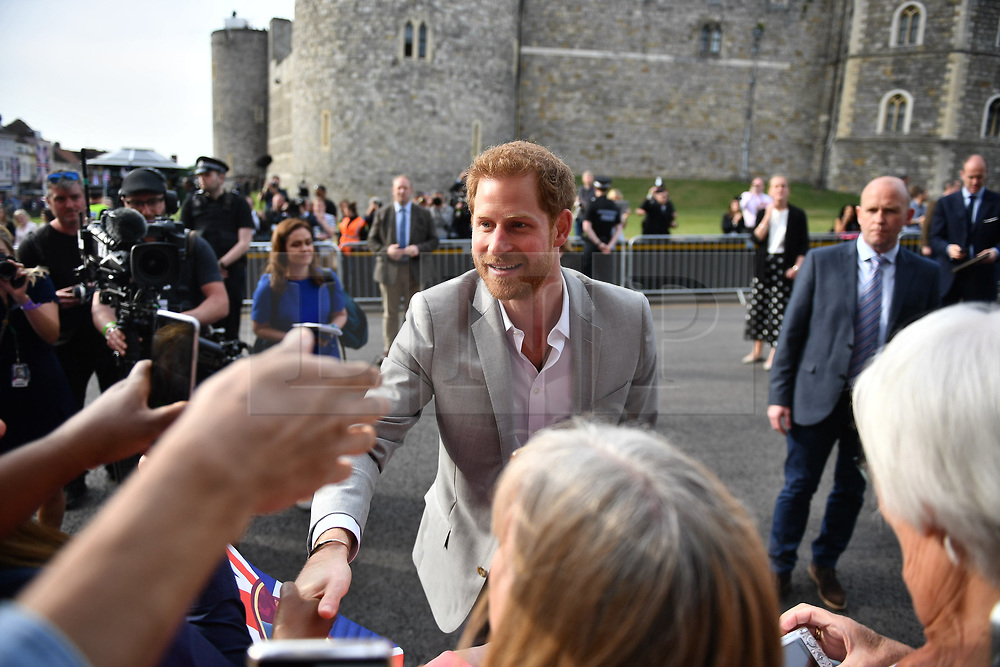 © Licensed to London News Pictures. 18/05/2018. London, UK. PRINCE HARRY and PRINCE WILLIAM meet royal fans outside Windsor Castle, on the eve of the wedding. Prince Harry and Meghan Markle are to be married tomorrow (Saturday) at St George's Chapel in Windsor. Photo credit: Ben Cawthra/LNP