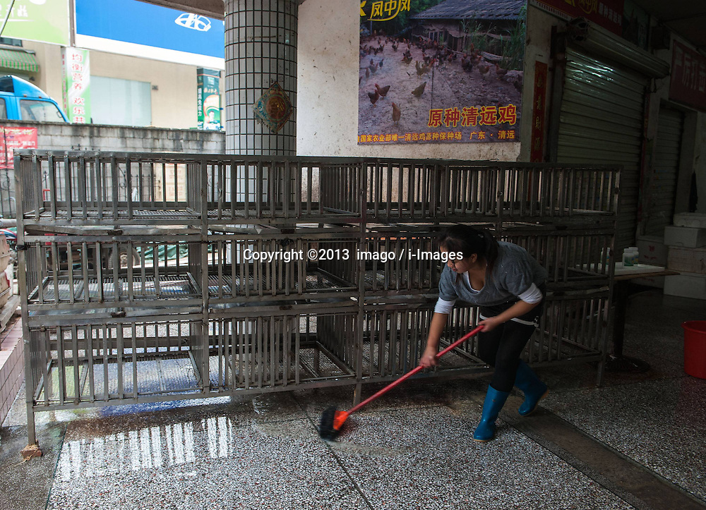 60827068  <br /> A worker disinfects the booth where samples were found positive at Kangqiao meat and vegetable market in Longgang District of Shenzhen City, south China s Guangdong Province, Dec. 13, 2013. Samples taken from two live poultry markets in Shenzhen have tested positive for H7N9 bird flu, the Guangdong provincial health authority confirmed on Wednesday. Guangdong health authorities warned the public to be aware of H7N9 transmission risks. The poultry markets where samples tested positive were asked to close for a week, Friday, 13th December 2013. Picture by  imago / i-Images